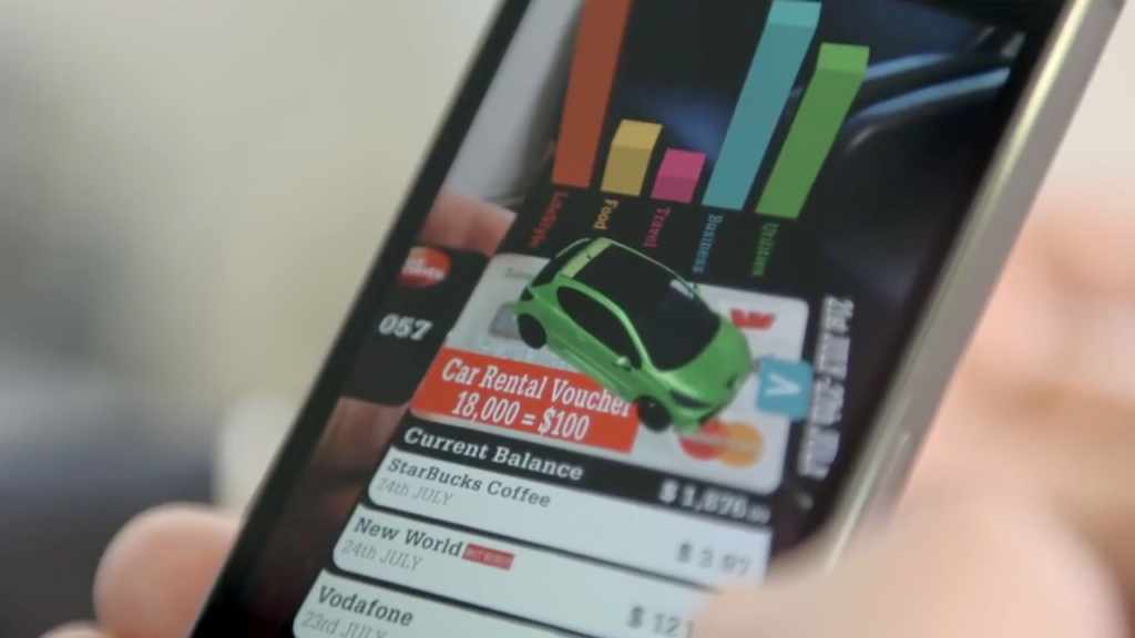 Augmented Reality For Banking Using Bank Card with 3D car and 3D graphs appearing on mobile phone screen