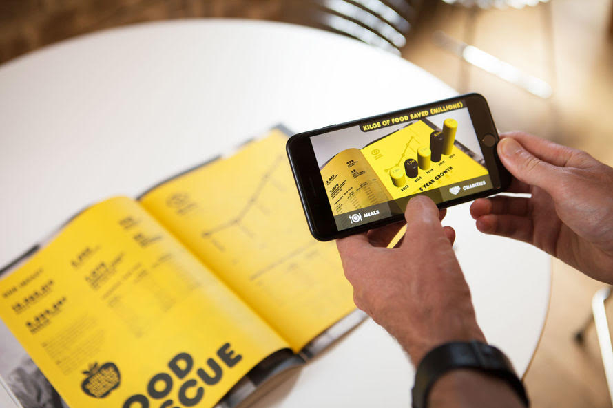 Augmented Reality For Banking, 3D graphs growing out of a book on a mobile phone screen