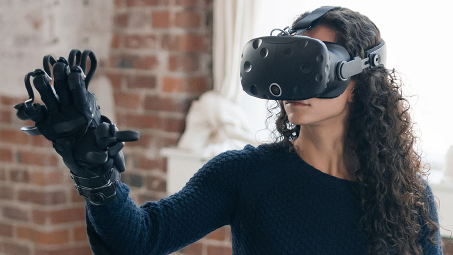 Woman Wearing VR Headset And Haptic Gloves