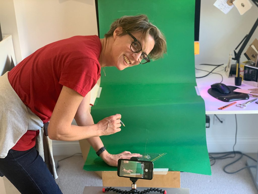 Sliced Bread creative director with basic green screen set up at home-office