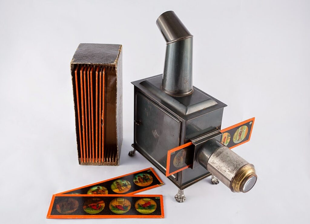 Picture of an antique magic lantern with example image slides