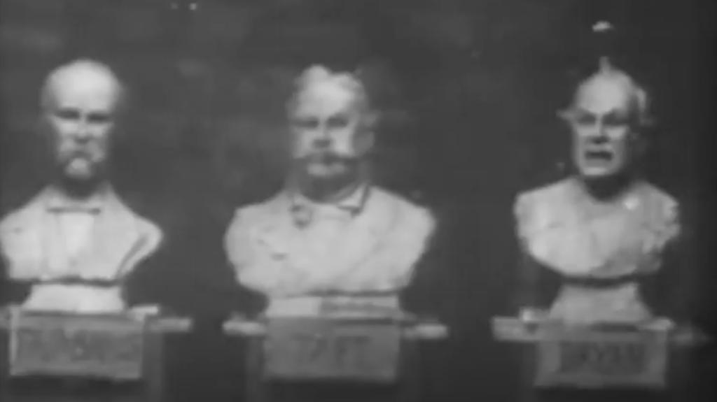 Three sculpted heads on plinths